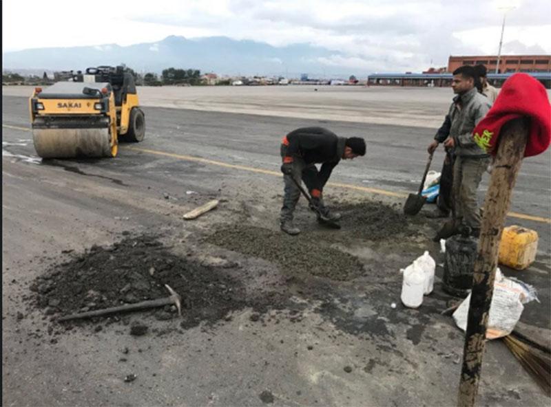 Potholes beeing repaired on Tribhuvan International Airport runway. File Photo
