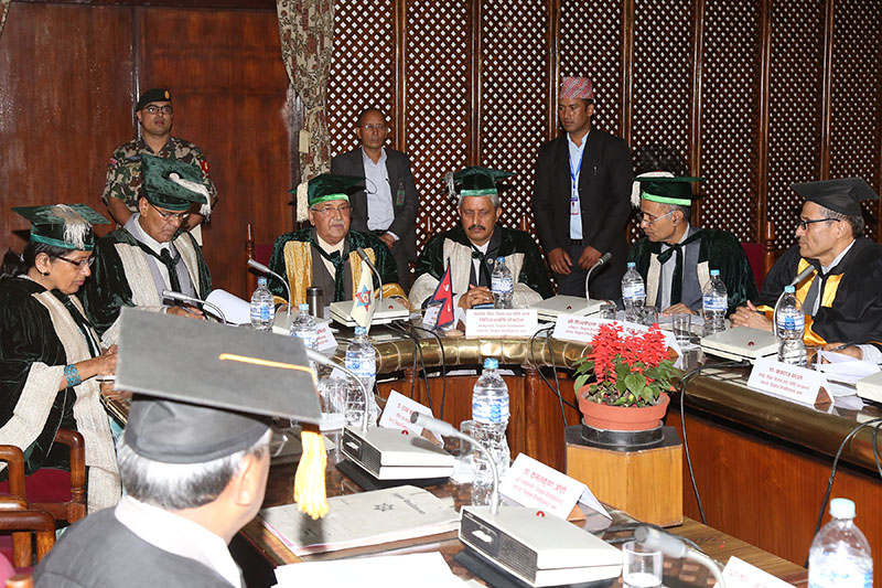 Prime Minister and Chancellor of Tribhuvan University KP Sharma Oli, along with Pro-Chancellor and Minister for Education, Science and Technology Giriraj Mani Pokhrel, Vice-Chancellor Tirtha Raj Khaniya, among others at the senate meeting marking the 59th anniversary of TU, in Kathmandu, on Saturday, July 21, 2018. Photo: RSS