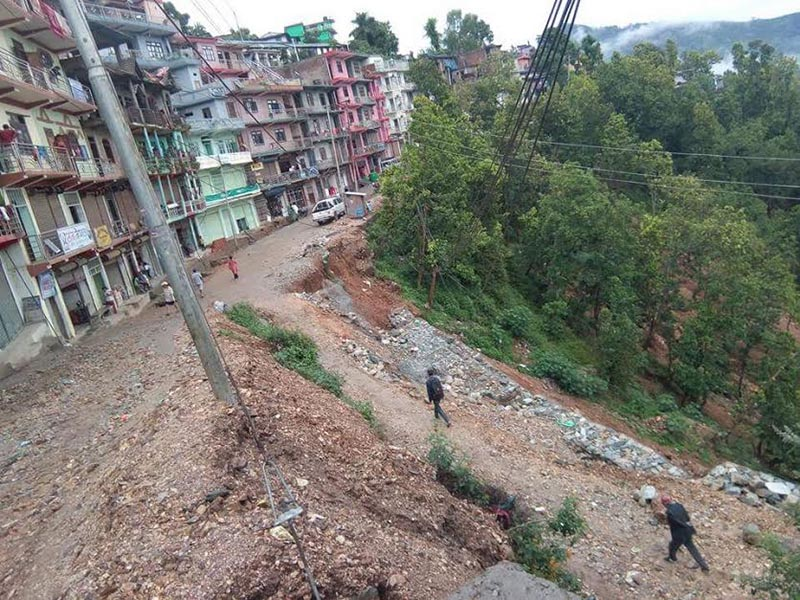 Houses at high risk of landslides in Tandi Bazaar of Khalanga, on Wednesday, July 4, 2018. Photo: THT
