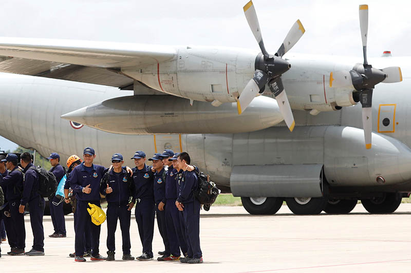 The Thai Navy pose for photo as they depart from Chiang Rai International Airport after finishing the rescue mission for 12 soccer players and their coach in Chiang Rai, Thailand July 12, 2018. Photo: Reuters