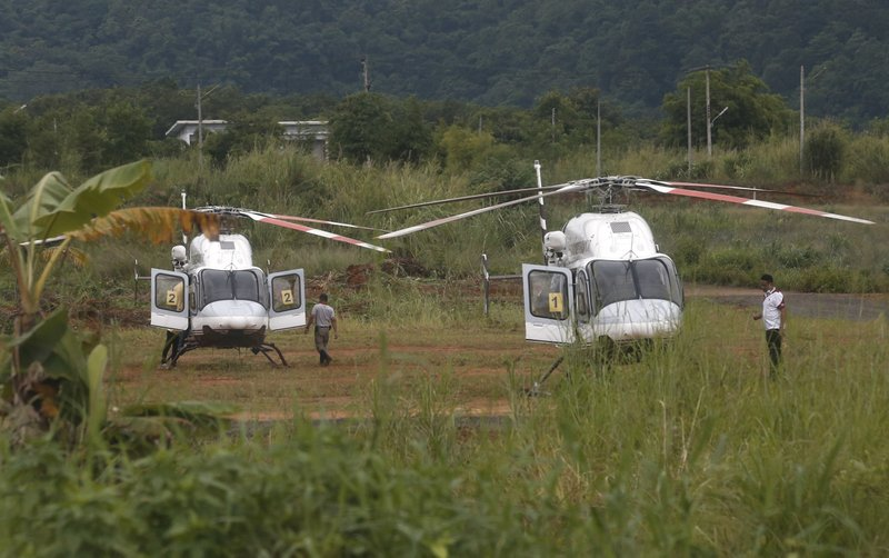 Two helicopters wait near the cave for more evacuations of the boys and their soccer coach who have been trapped since June 23, in Mae Sai, Chiang Rai province, northern Thailand on Monday, July 9, 2018. Photo: AP