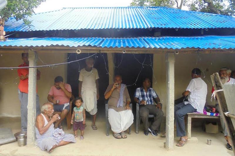 Locals gathering at a new house provided to flood victims in Tilathi Koiladi Rural Municipality, Saptari, on Monday, July 9, 2018. Photo: THT