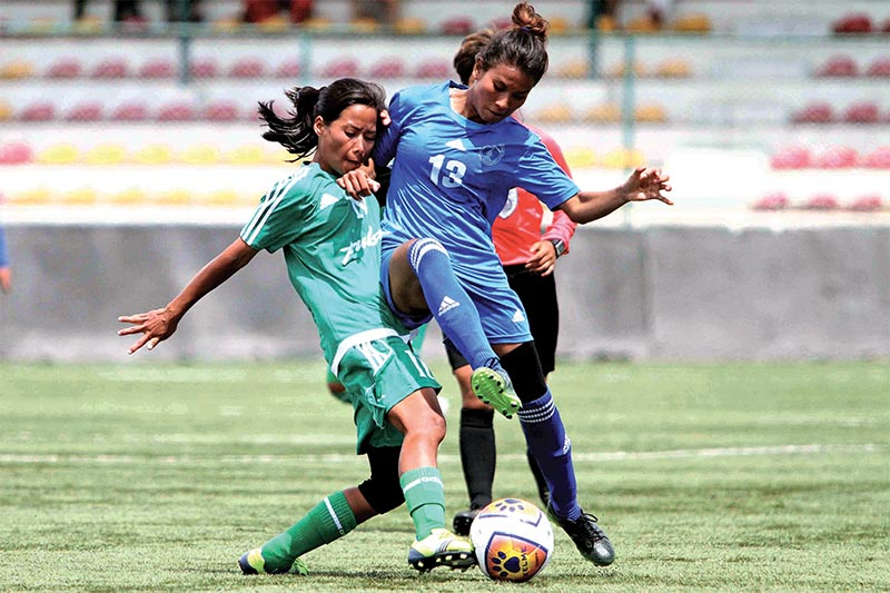 Indira Rai (left) of Tribhuvan Army Club vies for the ball agianst Siwani Kushwar of Nepal Police Club during Vice-president Women's Football League at ANFA ground in Satdobato, Lalitpur on Monday. Photo: Udipt Singh Chhetry/ THT