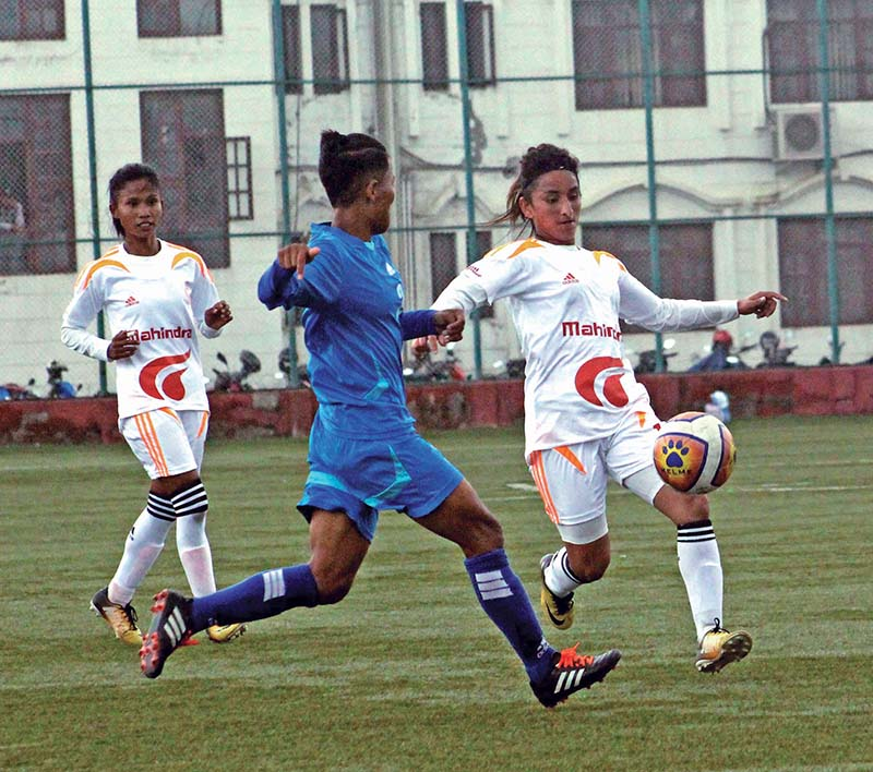 Players of NPC and Nepal APF Club (right) in action during the Vice- president Women's National Football League at the ANFA Complex in Lalitpur on Sunday. Photo: THT