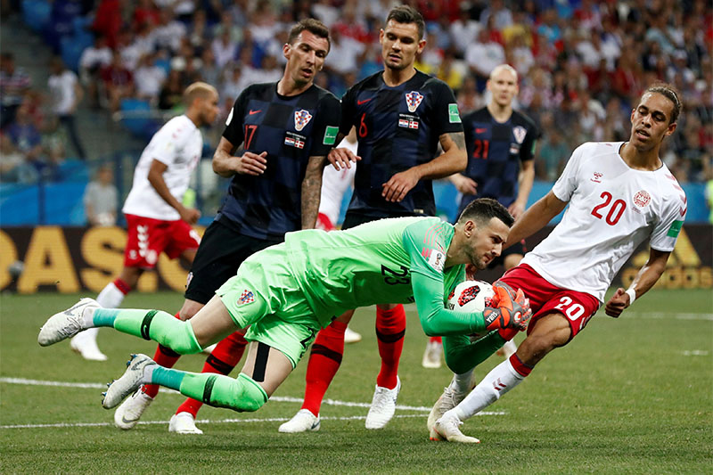 Croatia's Danijel Subasic makes a save from Denmark's Yussuf Poulsen during the World Cup Round of 16 match between Croatia and Denmark, at Nizhny Novgorod Stadium, in Nizhny Novgorod, Russia, on July 1, 2018. Photo: Reuters