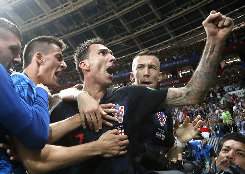 Croatia's Mario Mandzukic, center, celebrates after scoring his side's second goal during the semifinal match between Croatia and England at the 2018 soccer World Cup in the Luzhniki Stadium in Moscow, Russia, on Wednesday, July 11, 2018. Photo: AP