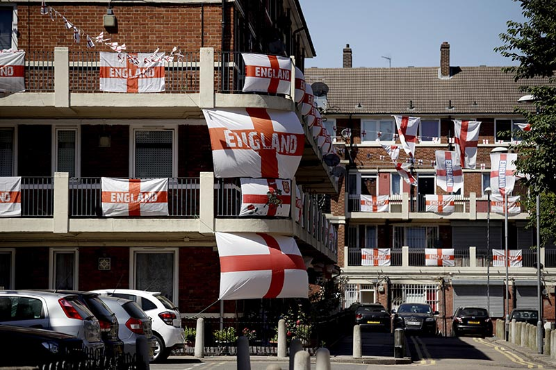 England flags put up by local residents for the World Cup are displayed on the Kirby Estate in south London, Monday, July 2, 2018. Photo: AP