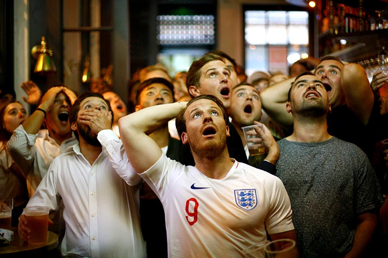 England fans react as they watch the World Cup semi-final match between Croatia and England, at Trafalgar Square, in London, Britain, on July 11, 2018. Photo: Reuters