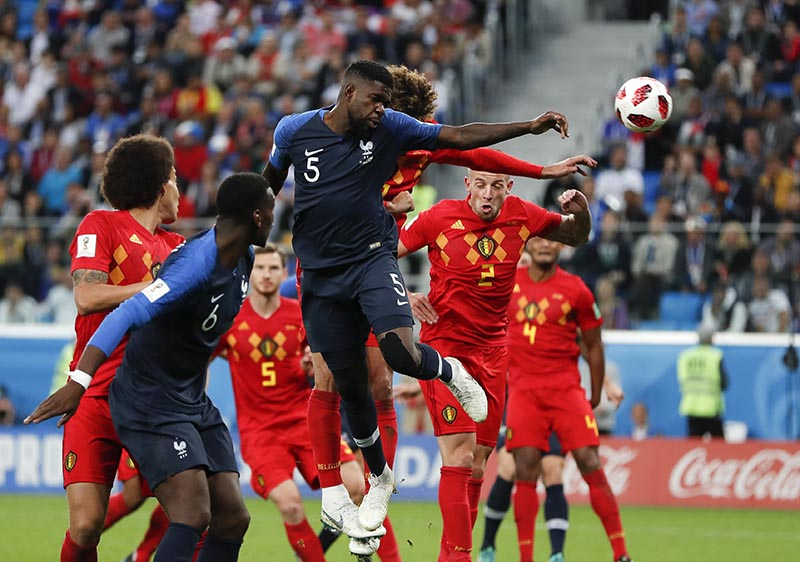 France's Samuel Umtiti, (5) heads the ball to score the opening goal of the game during the semifinal match between France and Belgium at the 2018 soccer World Cup in the St. Petersburg Stadium in, St. Petersburg, Russia, Tuesday, July 10, 2018. Photo: AP
