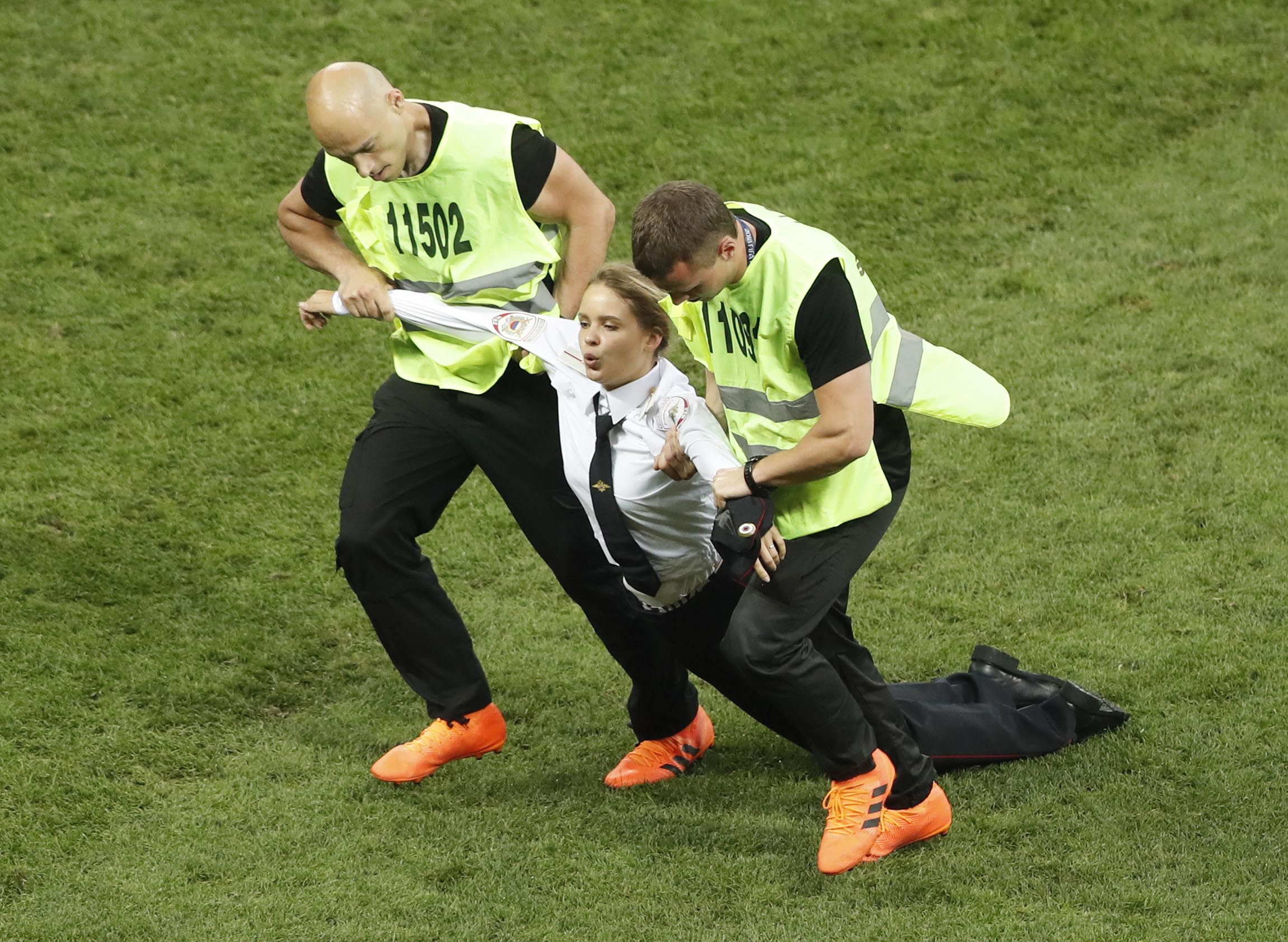 A woman is dragged away by stewards after running into the pitch during the final match between France and Croatia at the 2018 soccer World Cup in the Luzhniki Stadium in Moscow, Russia, Sunday, July 15, 2018. Photo: AP