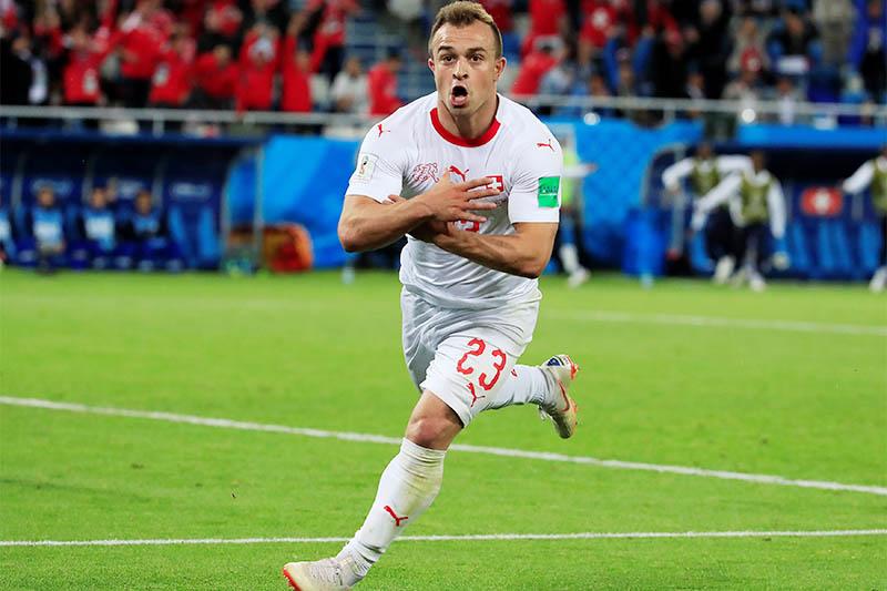 Switzerland's Xherdan Shaqiri celebrates scoring their second goal. Photo: Reuters
