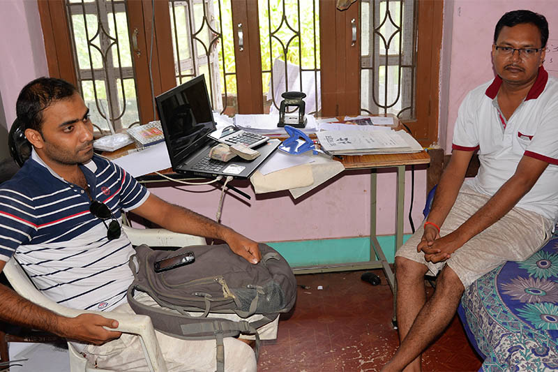 Two government employees caught red-handed while taking bribe from service seeker. Photo: Ram Sarraf