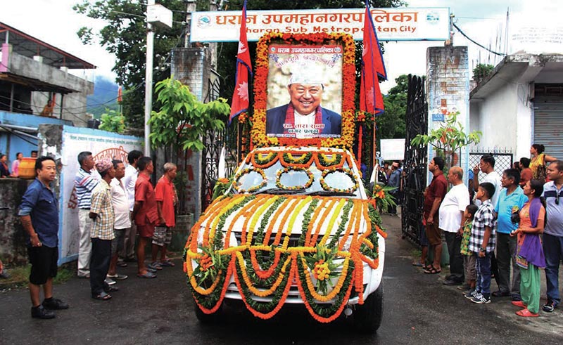 A vehicle carrying late Dharan Mayor Tara Subbau2019s portrait during his funeral procession, in Sunsari, on Saturday. Photo: THT