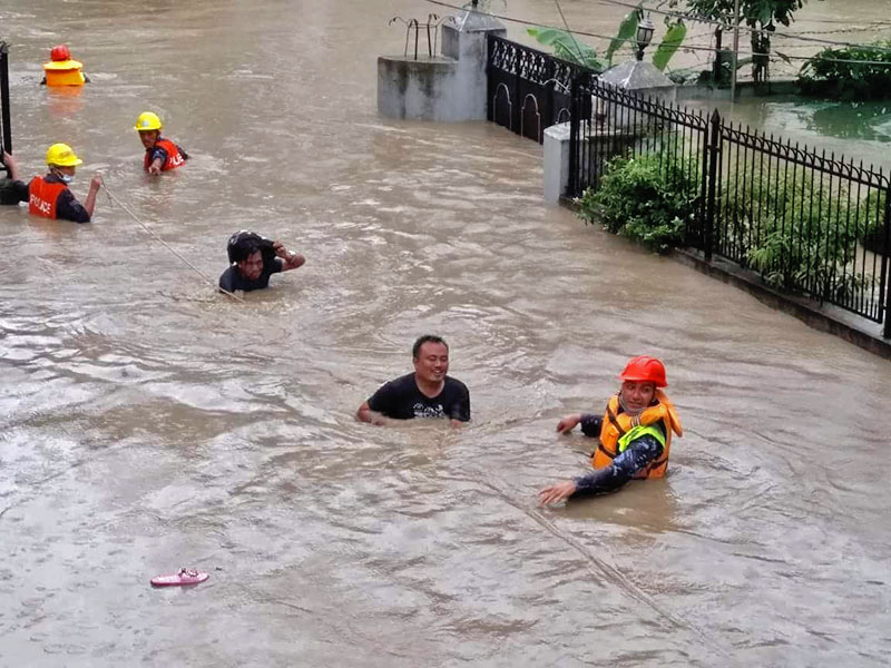People are being rescued to safe shelters after incessant rain and lack of drainage caused Hanumante River water level to rise to cause a deluge in Thimi, Bhaktapur, on Thursday, July 12, 2018. Photo courtesy: Kaushal Thakur