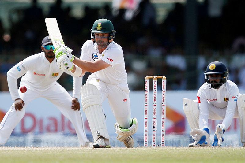 South Africa's Dean Elgar (C) hits a boundary next to Sri Lanka's wicketkeeper Niroshan Dickwella (R) and Dhananjaya de Silva (L). Photo: Reuters