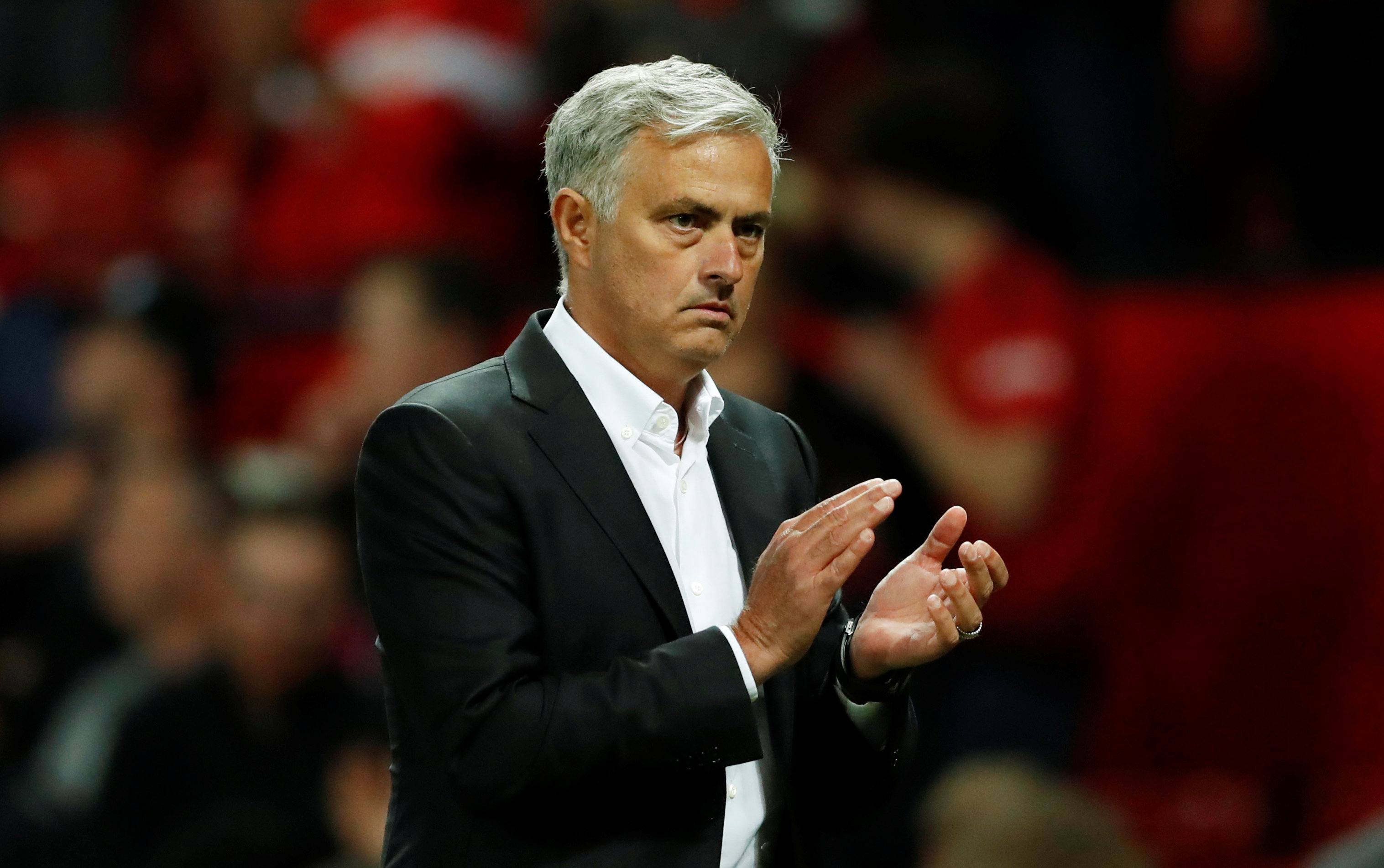 Soccer Football - Premier League - Manchester United v Leicester City - Old Trafford, Manchester, Britain - August 10, 2018  Manchester United manager Jose Mourinho applauds fans after the match. Photo:Reuters