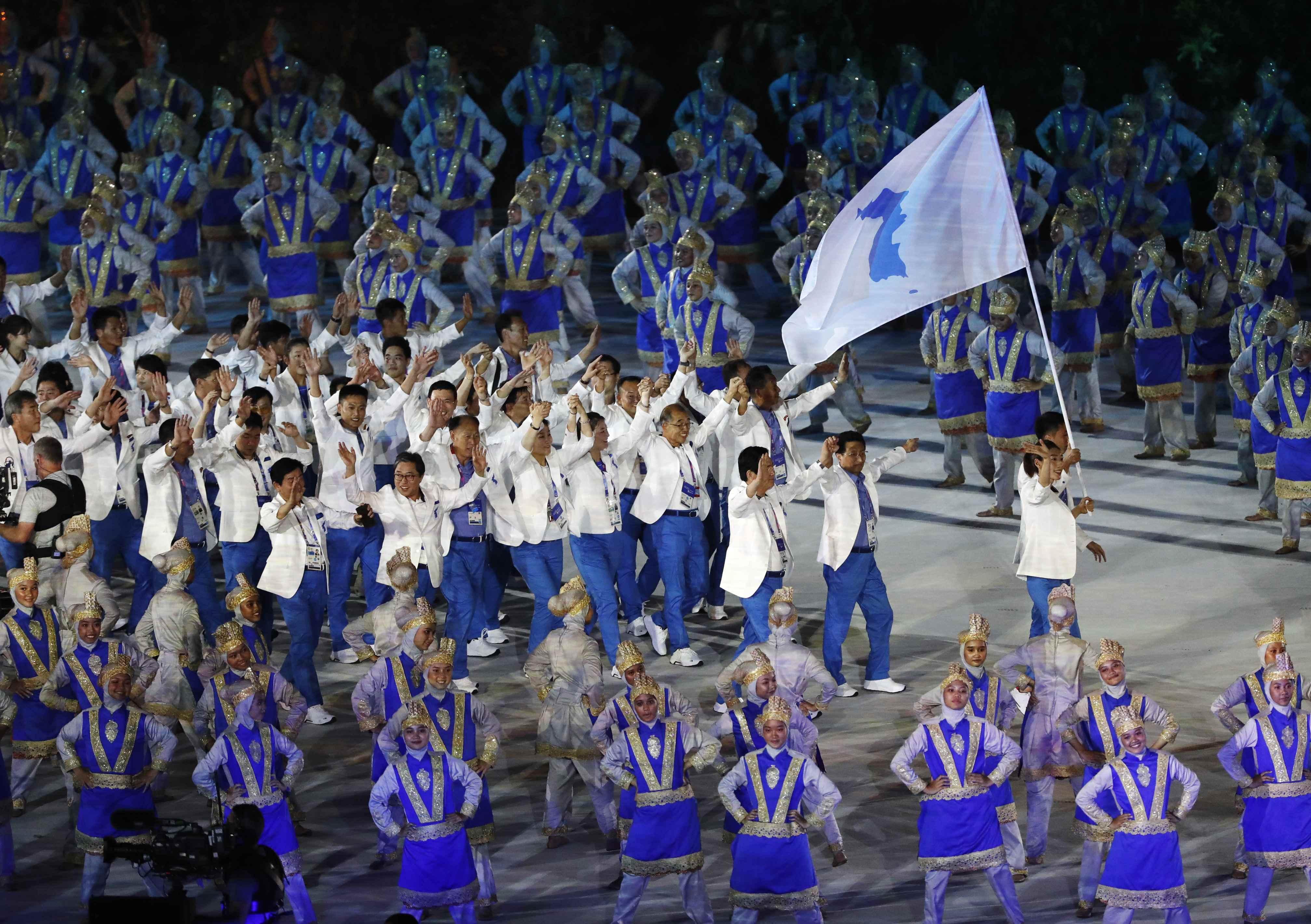 2018 Asian Games u2013 Opening ceremony - GBK Main Stadium u2013 Jakarta, Indonesia u2013 August 18, 2018 u2013 Athletes from the Unified Korea team march REUTERS