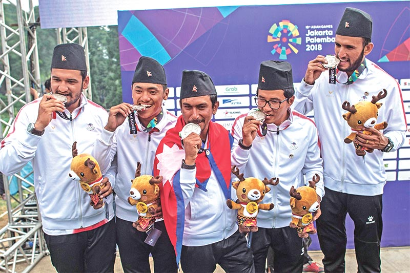 Nepalu2019s team posing with their silver medals during the awards ceremony for the paragliding menu2019s team cross country event during the 2018 Asian Games in Jakarta on Wednesday, August 29, 2018. Photo: AFP