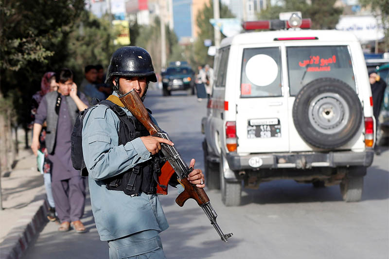 An Afghan policeman keeps watch near the site of a suicide bomb blast in Kabul, Afghanistan August 15, 2018. Photo: Reuters