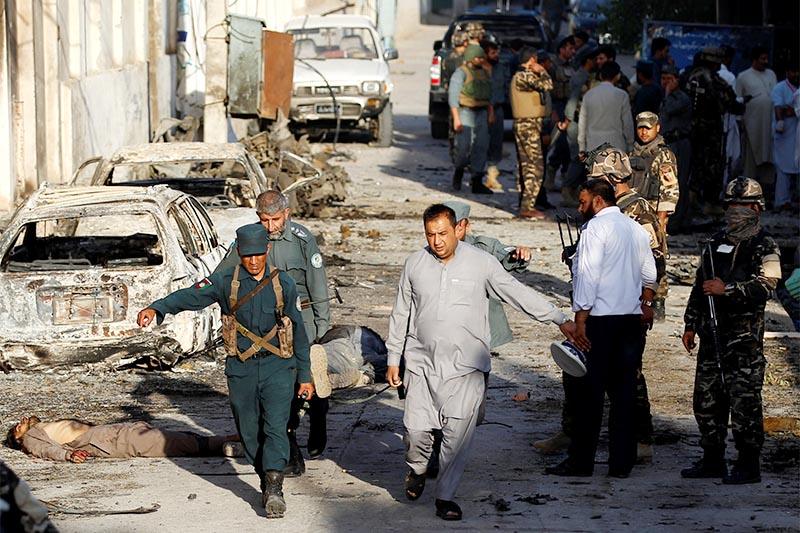 FILE PHOTO: Afghan security forces carry the body of a victim after an attack in Jalalabad, Afghanistan. Photo: Reuters