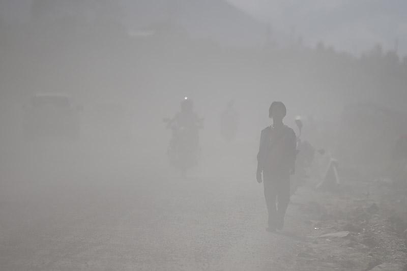 FILE: A man walks along a dusty road, in Kathmandu, on Tuesday, August 07, 2018. Photo: Skanda Gautam/THT