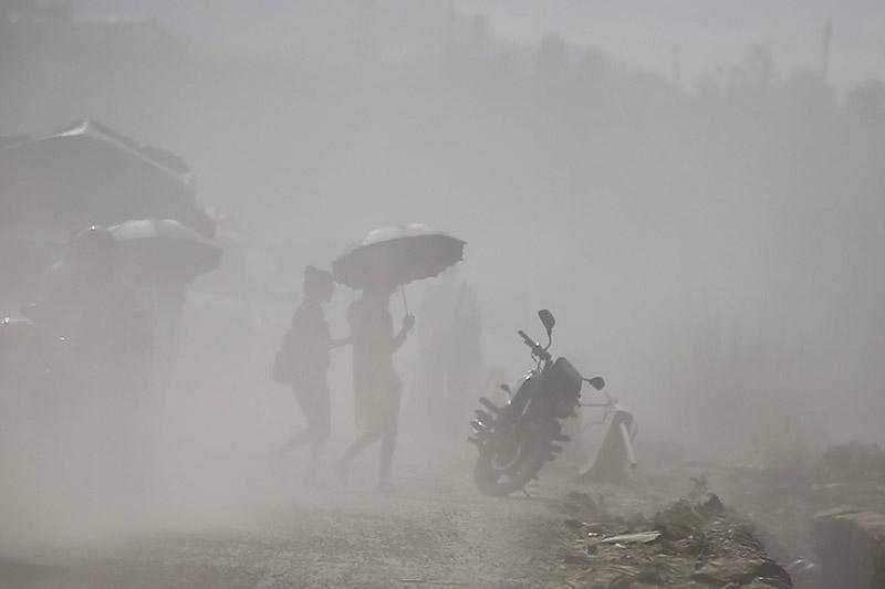 Women walk along a dusty road, in Kathmandu, on Tuesday, August 07, 2018. Photo: Skanda Gautam/THT