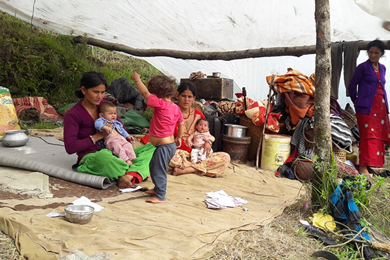 Families displaced due to the landslide and flood living under the tent in Kudi of Bajura, on Tuesday, August 21, 2018. Photo: Prakash Singh