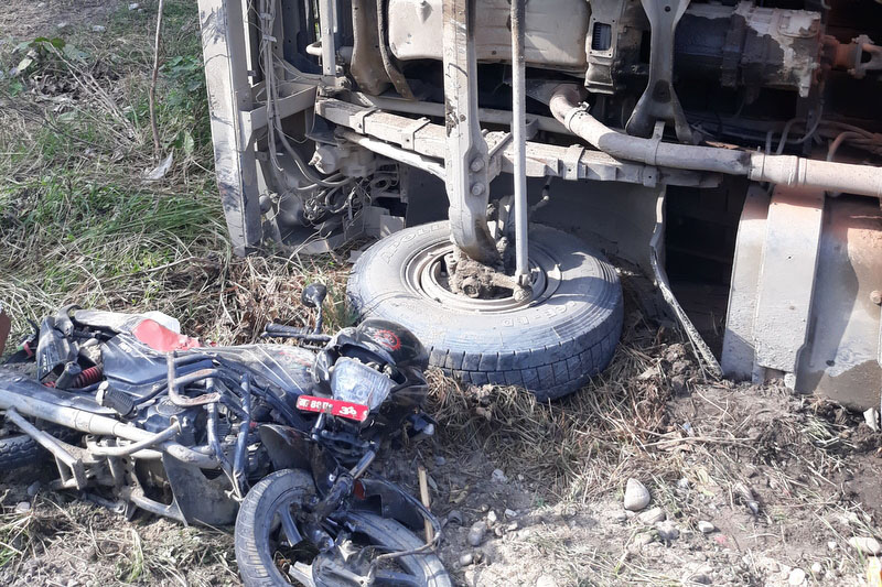 A wreckage of motorbike and a vehicle is seen at an accident site along East-West Highway in Bara district. Photo: Puspa Raj Khatiwada