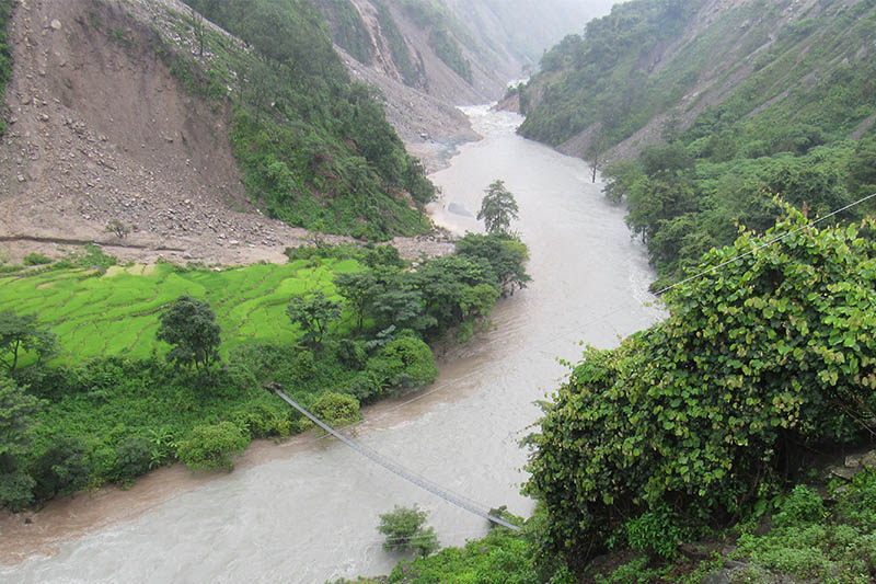 A view of swollen Budiganga river in Bajura district, on Monday, August 13, 2018. Photo: Prakash Singh