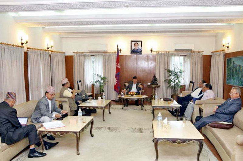 Senior leaders of Nepal Communist Party (NCP) including Co-chairs Pushpa Kamal Dahal, and KP Sharma Oli who is also Prime Minister, attend the party's secretariat meeting at latter's official residence in Baluwatar, Kathmandu, on Thursday, August 9, 2018. Courtesy: Twitter/@cmprachanda