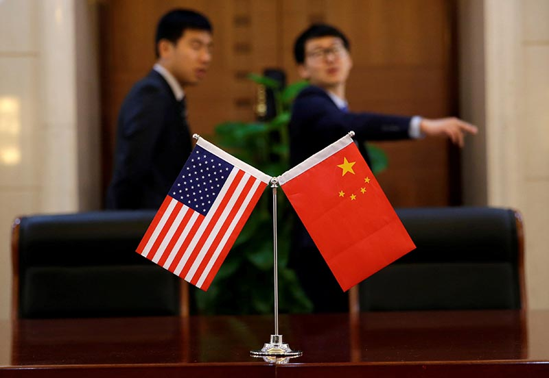 Chinese and US flags are set up for a signing ceremony during a visit by US Secretary of Transportation Elaine Chao at China's Ministry of Transport in Beijing, China, on April 27, 2018.  Photo: Reuters
