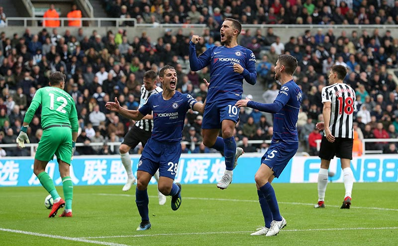 Chelsea's Eden Hazard celebrates scoring their first goal with Cesar Azpilicueta and Jorginho during the Premier League match between Newcastle United and  Chelsea, at St James' Park, in Newcastle, Britain, on August 26, 2018. Photo: Reuters