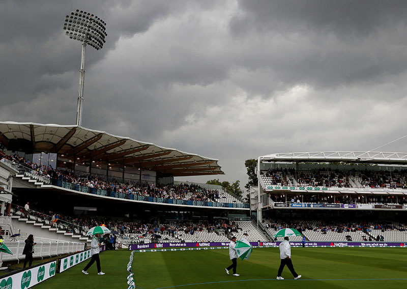 Umpires walk on the pitch during a rain delay the second test match between England and India, London, Britain, on August 9, 2018. Photo: Action Images via Reuters