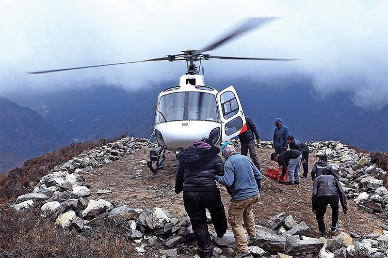 File - An unidentified injured person preparing to board a helicopter at Mong La village near Namche Bazaar, in Solukhumbu district, on April 17, 2018. Photo: AFP