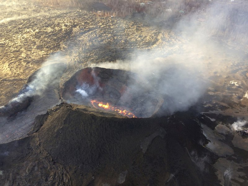 In this aerial photo provided by the U.S. Geological Survey, lava from the last active eruption site on Hawaiiu2019s Kilauea volcano is shown near Pahoa, Hawaii on  Sunday, Aug. 5, 2018. Photo: AP