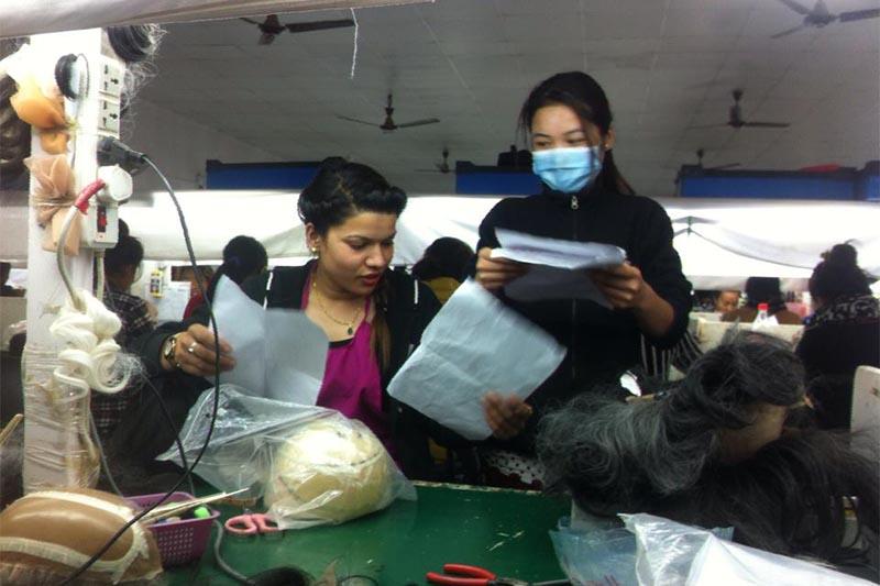 This undated image shows employees working at Hi-Art Nepal Pvt Ltd in Kathmandu. Photo: Hi-Art Nepal Pvt Ltd