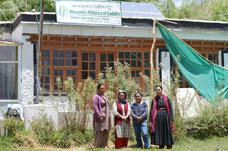 Tsering Chondol (far right), the president of the Women's Alliance of Ladakh, poses for a photo with three other members of the organisation, outside their office in Leh, India, June 1, 2018. Photo: Reuters