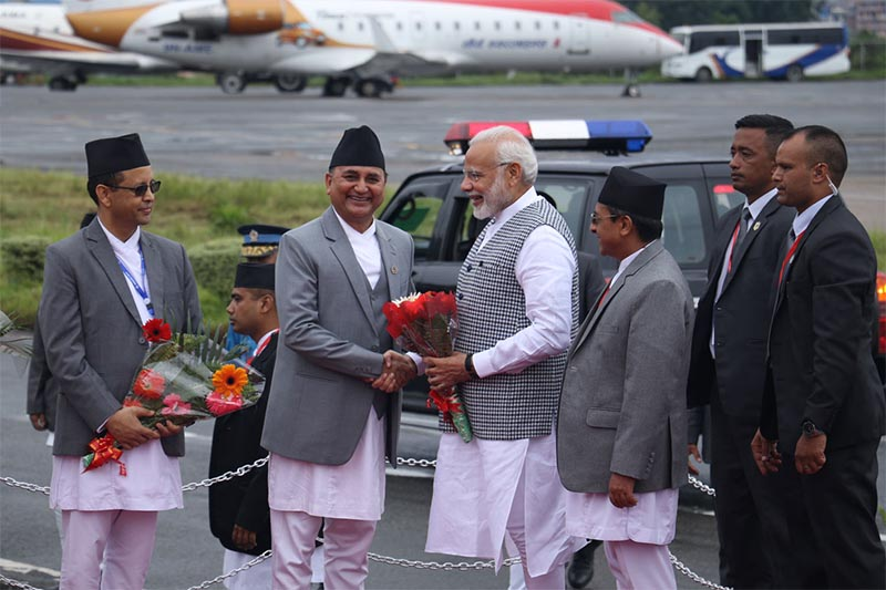 Deputy Prime Minister and Defence Minister Ishwor Pokhrel shakes hands with Indian Prime Minister Narendra Modi (centre) while receiving him upom his arrival at Tribhuvan International Airport (TIA), in Kathmandu, on Thursday, August 30, 2018. Photo: RSS