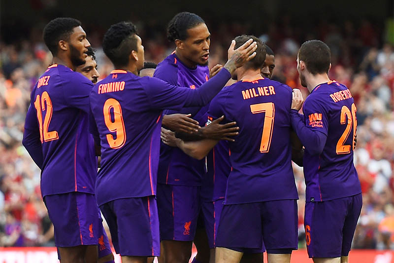 Liverpool's Georginio Wijnaldum celebrates scoring their second goal with teammates. Photo: Reuters