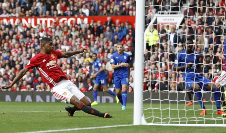 FILE PHOTO: Britain Football  - Manchester United v Leicester City - Premier League - Old Trafford - 24/9/16nManchester United's Marcus Rashford scores their third goal. PHOTO:REUTERSn