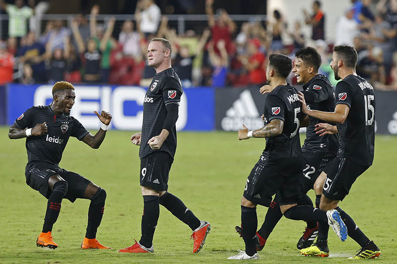 DC United forward Wayne Rooney (9) celebrates with teammates after scoring a goal on a free kick against Portland Timbers in the second half at Audi Field, in Washington, DC, USA, on August 15, 2018. Photo: Geoff Burke-USA TODAY Sports via Reuters