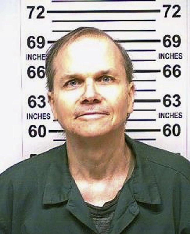 FILE- This photo, provided by the New York State Department of Corrections, shows Mark David Chapman, the man who killed John Lennon on Dec. 8, 1980. Photo: AP