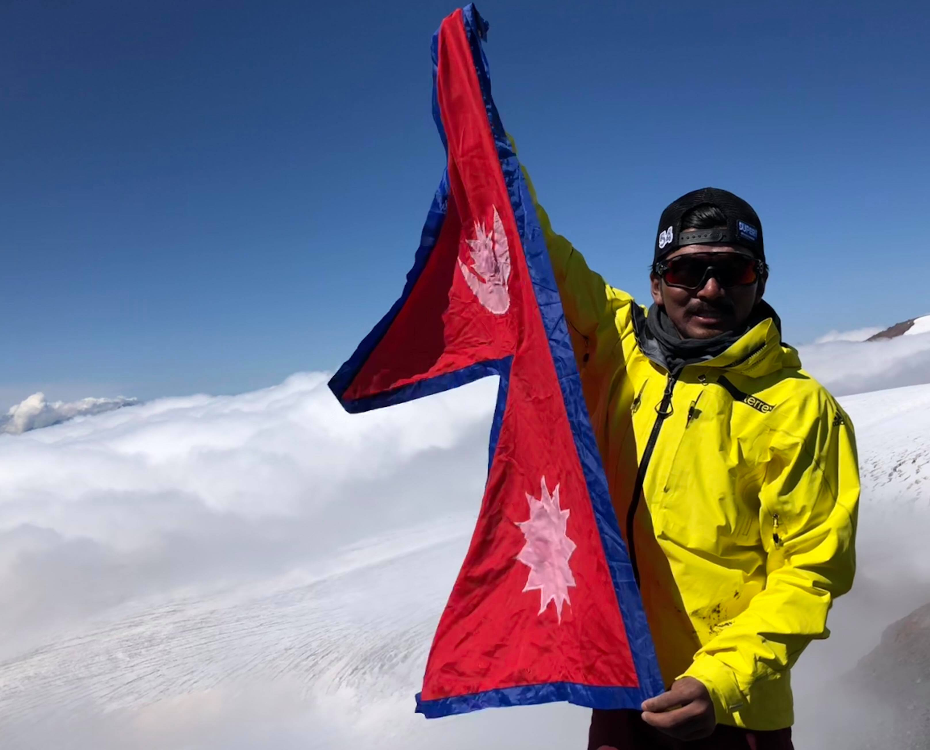Mingma David Sherpa poses for a photo atop Mt Elbrus, the highest mountain in Europe. Photo:Mingma David Sherpa