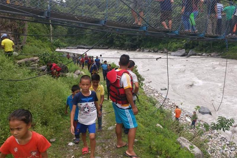 People gathering at a site where a car fell into the Myagdikhola River, in Myagdi, on Friday, August 3, 2018. Photo: THT