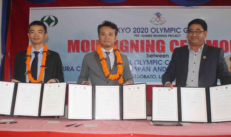 From left Soko Aoki General Secretary of Athelet Society, Naoyuki Kawagoishi Deputy Mayor of Tamura City and Jeevan Ram Shrestha President of Nepal Olympic Committee show Memorandum of Understading after tri-party signing ceremony at Nepal Olympic Committee in Satdobato, Lalitpur on Friday, August 3, 2018. Photo: THT