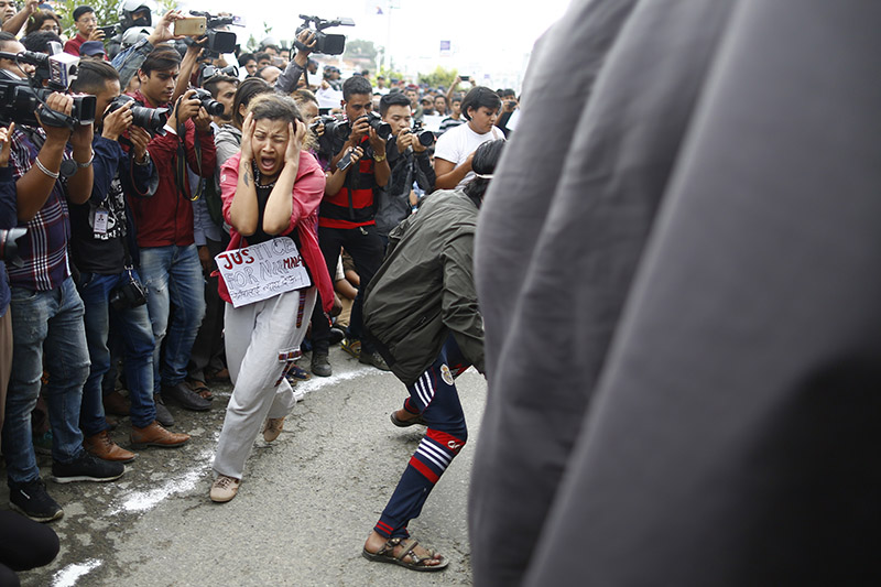 Protesters stage a symbolic street play demanding justice for13-year-old Nirmala Panta of Kanchanpur who was brutually raped and murdered, in Kathmandu, on Saturday, August 25, 2018. Photo: Skanda Gautam/THT