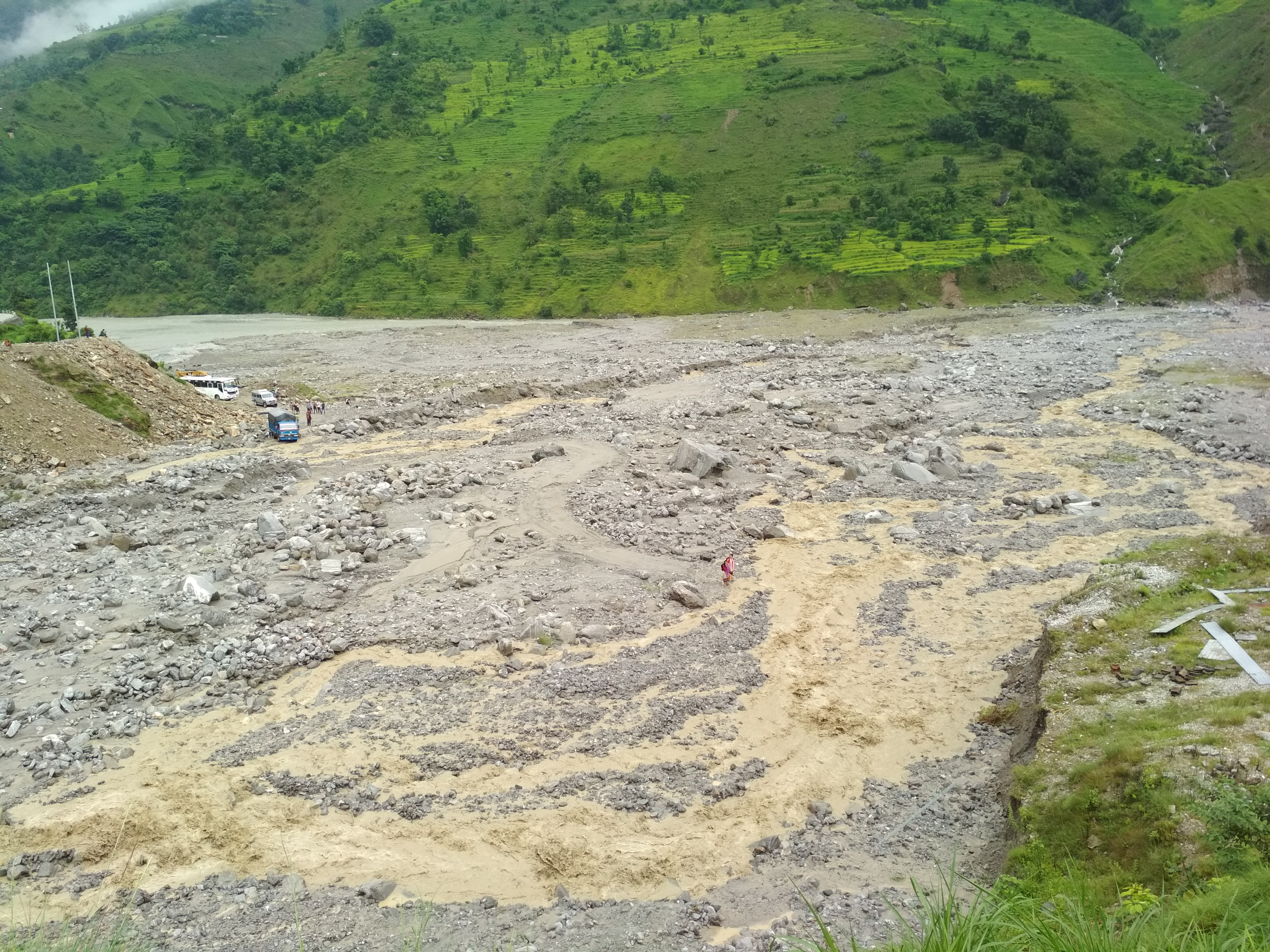 Swollen Budiganga River pictured at Guigad along Sanfe Martadi road section. The river has swept away the road halting vehicular movement. Photo: Prakash Singh/THT