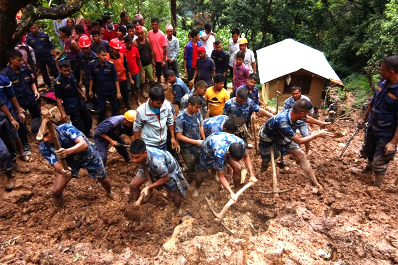 Police personnel remove the debris of a landslip to search for the missing persons buried along with two houses at Thati Bazaar in Jajarkot on Sunday, August 05, 2018. Photo: Dinesh Kumar Shrestha