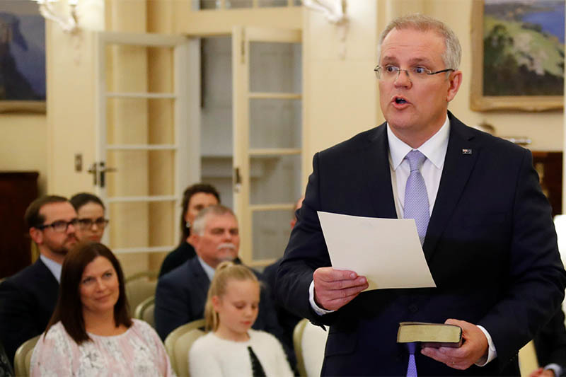 The new Australian Prime Minister Scott Morrison attends a swearing-in ceremony as his wife Jenny looks on, in Canberra, Australia August 24, 2018. Photo: Reuters