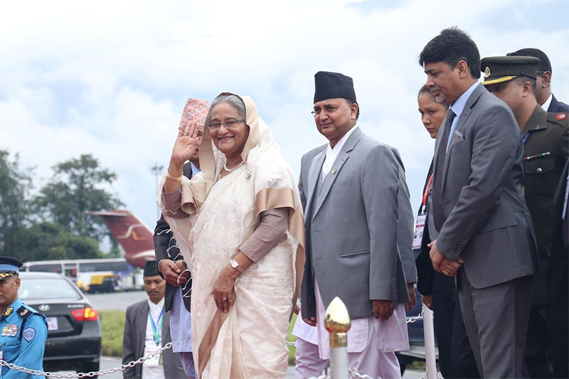 Prime Minister of Bangladesh Sheikh Hasina Wazed waves while Deputy Prime Minister and Defence Minister Ishwor Pokhrel receives her upon her arrival at Tribhuvan International Airport, in Kathmandu, on Thursday, August 30, 2018. Photo: RSS